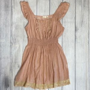 Mine pale pink with ruffles and lace. Size L